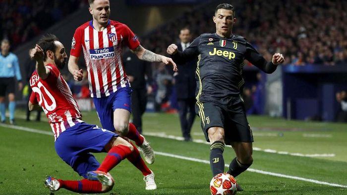 Cristiano Ronaldo dapat serangan verbal dari pendukung Atletico Madrid (REUTERS/Juan Medina)