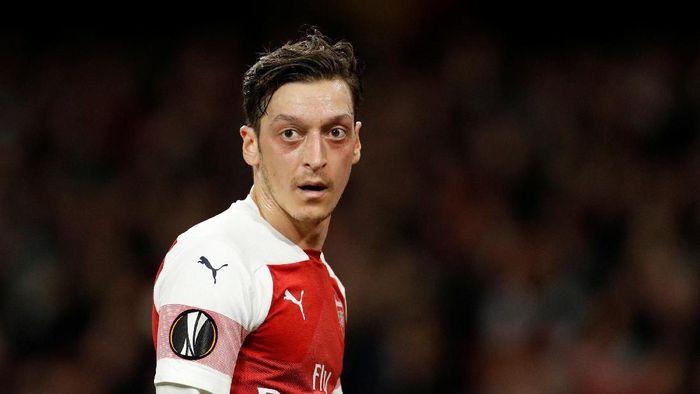 Mesut Oezil jadi starter lagi setelah dua bulan terakhir (John Sibley/Reuters)