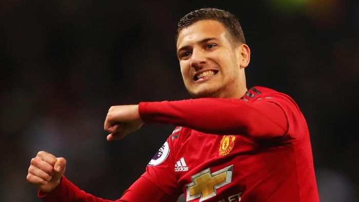 LONDON, ENGLAND - JANUARY 13:  Diogo Dalot of Manchester United celebrates victory after the Premier League match between Tottenham Hotspur and Manchester United at Wembley Stadium on January 13, 2019 in London, United Kingdom.  (Photo by Catherine Ivill/Getty Images)