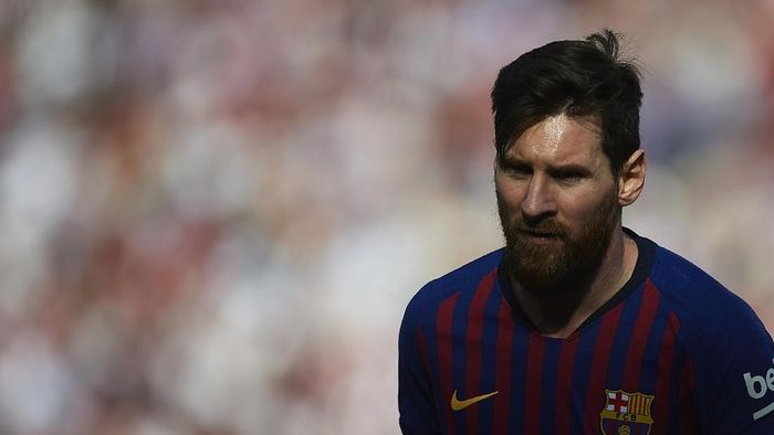 Lionel Messi mencetak hat-trick kala Barcelona membungkam Sevilla 4-2. (Foto: Aitor Alcalde/Getty Images)