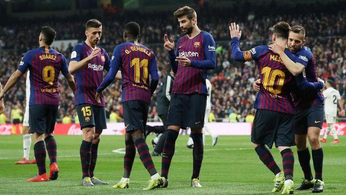 Barcelona tampil efektif untuk menyingkirkan Real Madrid di semifinal Copa del Rey. Foto: Susana Vera / Reuters