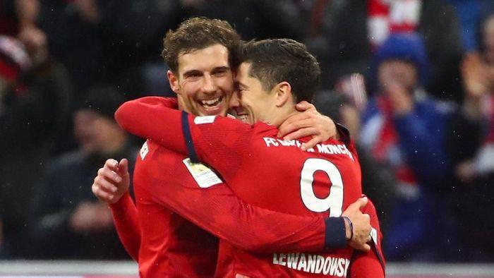 Robert Lewandowski kini tercatat sebagai pemain asing paling subur di Bundesliga (Foto: Michael Dalder/Reuters)