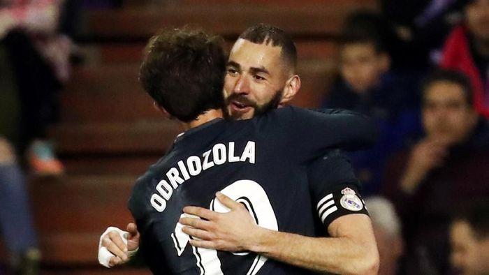 Karim Benzema bikin dua gol saat Real Madrid menggilas Valladolid 4-1 (REUTERS/Sergio Perez)