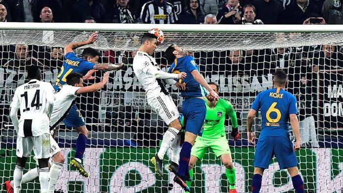 Cristiano Ronaldo bawa Juventus ke perempatfinal. (Foto: Massimo Pinca/Reuters)