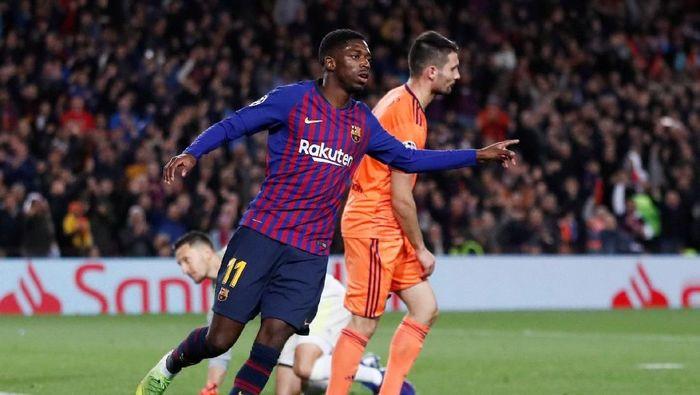 Ousmane Dembele mengalami cedera hamstring dan akan absen membela Barcelona sampai empat pekan ke depan (Foto: Juan Medina/Reuters)