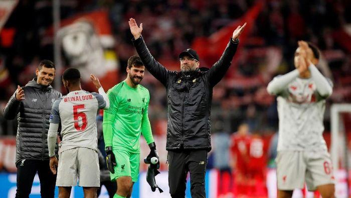 Liverpool menang meyakinkan dengan skor 3-1 di kandang Bayern Munich untuk lolos ke perempatfinal Liga Champions (Action Images via Reuters / Andrew Boyers)