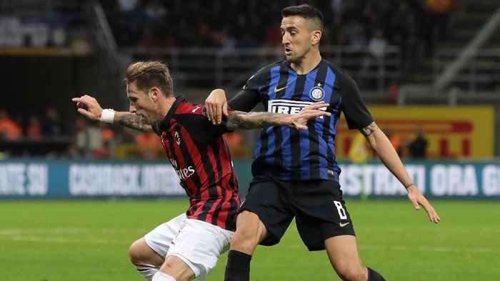 AC Milan dan Inter Milan akan berduel di Liga Italia akhir pekan ini (Foto: Emilio Andreoli/Getty Images)