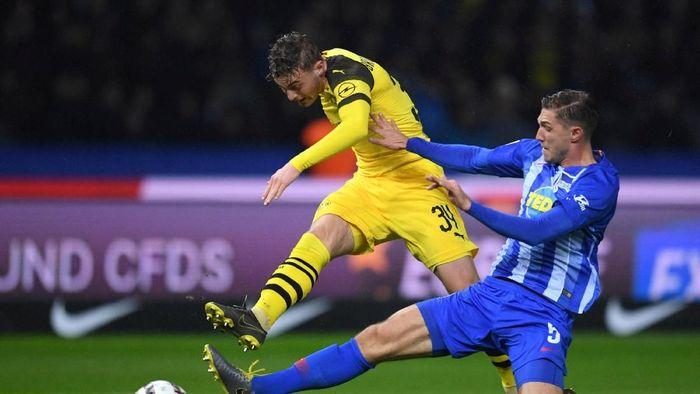 Borussia Dortmund menang dramatis 3-2 atas Hertha Berlin. (Foto: Annegret Hilse/REUTERS)