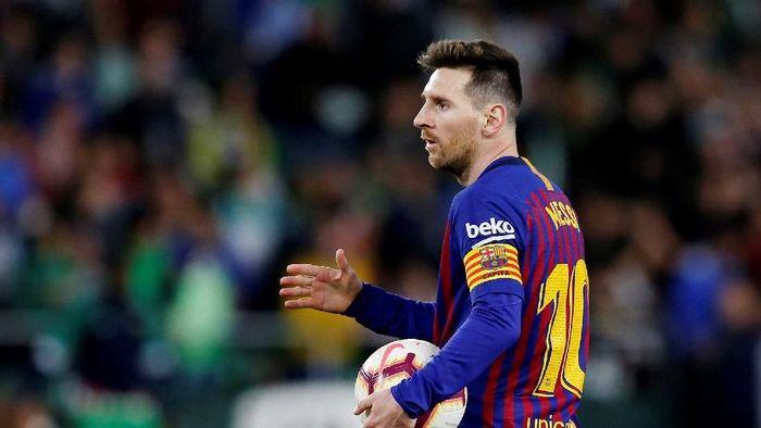 Lionel Messi bikin hat-trick ke gawang Real Betis (Marcelo del Pozo/REUTERS)