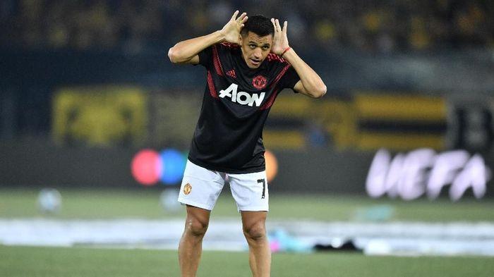 Alexis Sanchez cuma sekali menyentuh bola saat Manchester United kalah dari Manchester City (Fabrice COFFRINI / AFP)