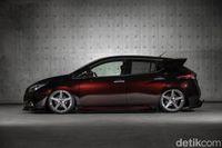 Modifikasi kendaraan beroda empat listrik Nissan Leaf.