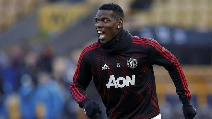 Paul Pogba tak menjadi contoh dan rekan yang baik di Manchester United, kata Roy Keane (REUTERS/Andrew Yates)