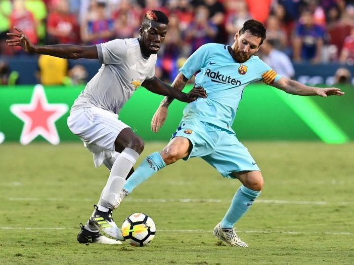 Manchester United vs Barcelona: Performa Paul Pogba dan Lionel Messi akan menentukan penampilan masing-masing tim. Foto: Nicholas Kamm / AFP
