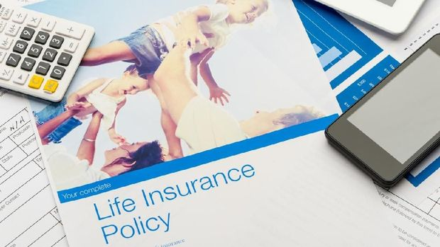 Close up of a Life insurance policy with family image. The included image can be found in my portfolio. Image  #37803180