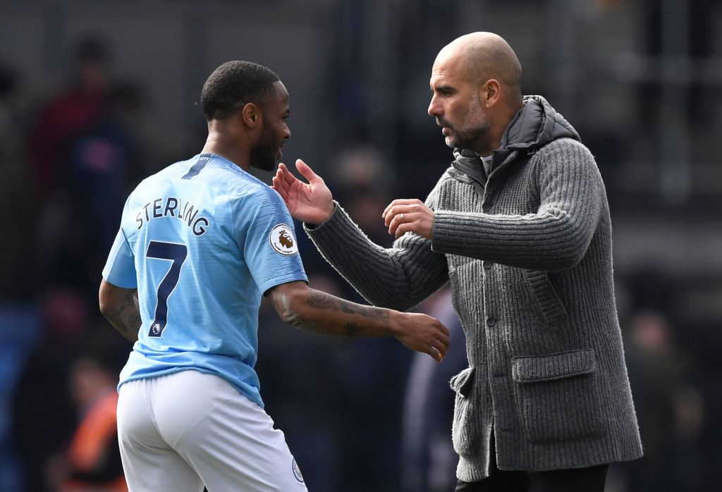 Soccer Football - Premier League - Crystal Palace v Manchester City - Selhurst Park, London, Britain - April 14, 2019  Manchester City's Raheem Sterling celebrates after the match with manager Pep Guardiola      Action Images via Reuters/Tony O'Brien  EDITORIAL USE ONLY. No use with unauthorized audio, video, data, fixture lists, club/league logos or