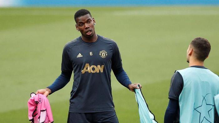 Paul Pogba dikabarkan sudah pamit ke pemain-pemain Manchester United  (Action Images via Reuters/Carl Recine)