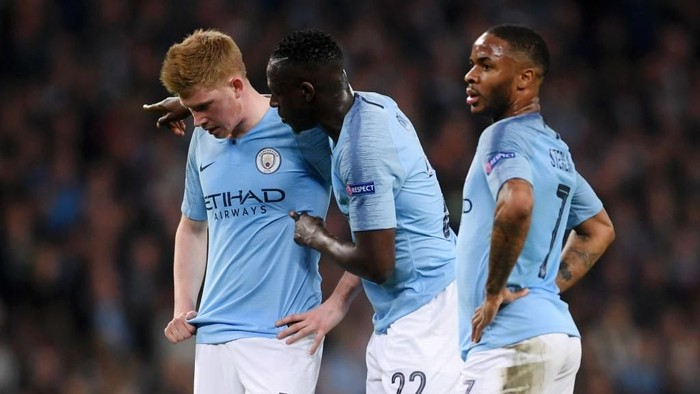 MANCHESTER, ENGLAND - APRIL 17:  Kevin De Bruyne of Manchester City Benjamin Mendy of Manchester City and Raheem Sterling of Manchester City look on during the UEFA Champions League Quarter Final second leg match between Manchester City and Tottenham Hotspur at at Etihad Stadium on April 17, 2019 in Manchester, England. (Photo by Laurence Griffiths/Getty Images)