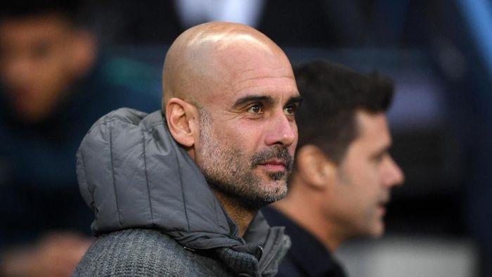 Ekspresi Guardiola bermacam-macam. Manajer asal Spanyol itu dibuat bak roller coaster sepanjang laga. (Foto: Laurence Griffiths/Getty Images)