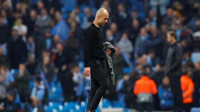 Manajer Manchester City Pep Guardiola usai disingkirkan Tottenham Hotspur di perempatfinal Liga Champions. (Foto: Phil Noble/Reuters)