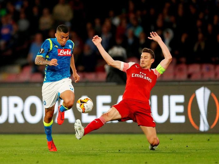 Saat bertanding di Stadio San Paolo, Jumat (19/4/2019) dinihari WIB, Arsenal memetik kemenangan dengan skor akhir 1-0. Dengan hasil itu, The Gunners lolos ke semifinal dengan agregrat meyakinkan 3-0. (Foto: Matthew Childs/Action Images via Reuters)