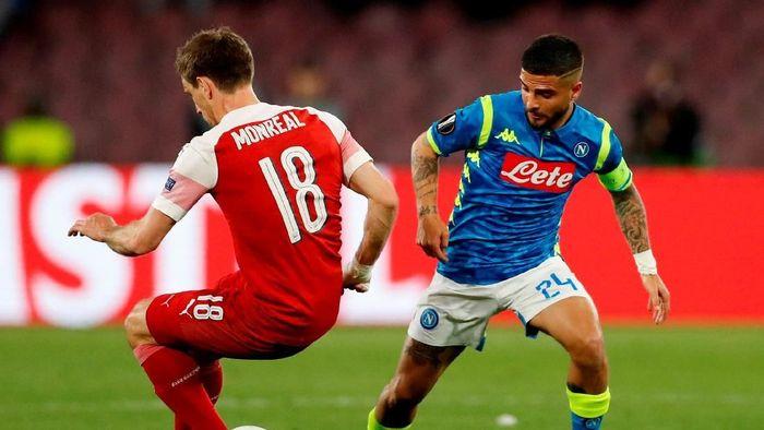 Kemenangan itu didapat dengan tak gampang. Arsenal harus menahan gempuran Napoli. Ada 20 tembakan ke arah gawang Gudang Peluru, tiga mencapai sasaran, tak ada yang berbuah gol. (Foto: Matthew Childs/Action Images via Reuters)