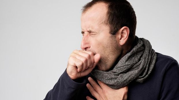 Mature man in scarf is ill from colds or pneumonia. Suffering from flu virus.