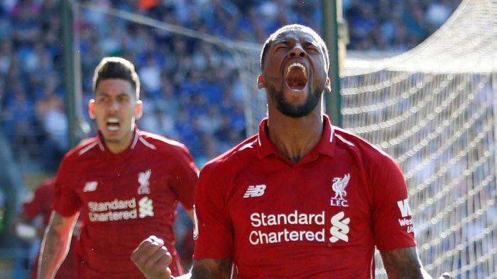 Pemain Liverpool, Giorginio Wijnaldum, merayakan gol ke gawang Cardiff City. The Reds menang 2-0 dalam laga itu. (Foto: Carl Recine/Action Images via Reuters)