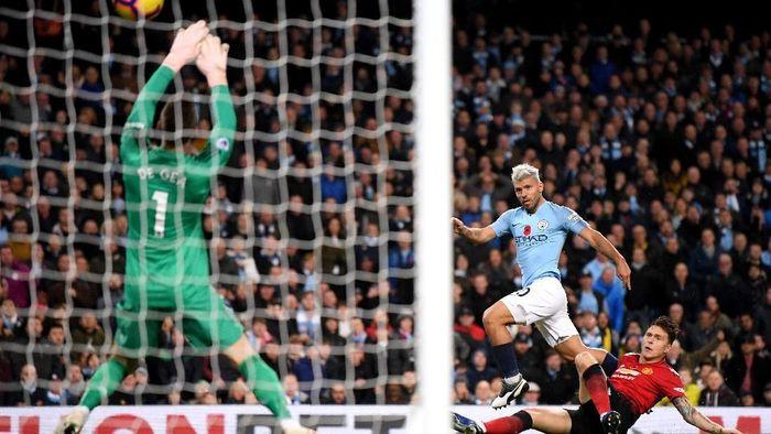 Sergio Aguero sudah delapan kali membobol gawang Manchester United di Premier League (Foto: Laurence Griffiths/Getty Images)