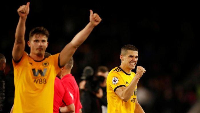Pemain Wolverhampton Wanderers merayakan kemenangan 3-1 atas Arsenal di Liga Inggris, Kamis (25/4/2019) dini hari WIB. (Foto: Andrew Boyers/Reuters)