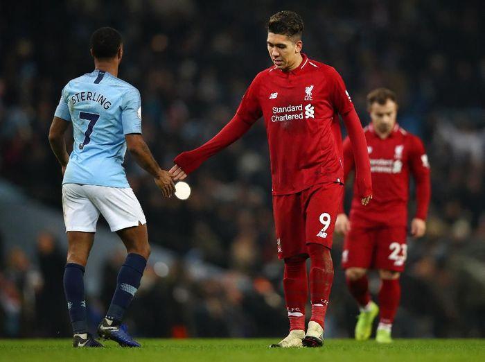 Manchester City dan Liverpool bersaing ketat di Liga Inggris. (Foto: Clive Brunskill/Getty Images)
