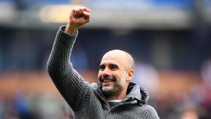 Pep Guardiola raih gelar pelatih terbaik Premier League (Michael Regan/Getty Images)