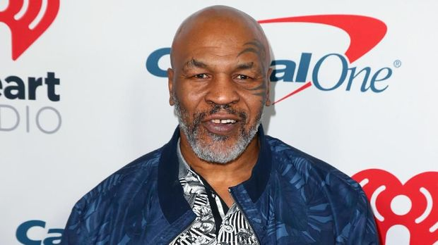 BURBANK, CALIFORNIA - JANUARY 18: (EDITORIAL USE ONLY. NO COMMERCIAL USE) Mike Tyson arrives at the 2019 iHeartRadio Podcast Awards Presented by Capital One at the iHeartRadio Theater LA on January 18, 2019 in Burbank, California.   Joe Scarnici/Getty Images for iHeartMedia/AFP