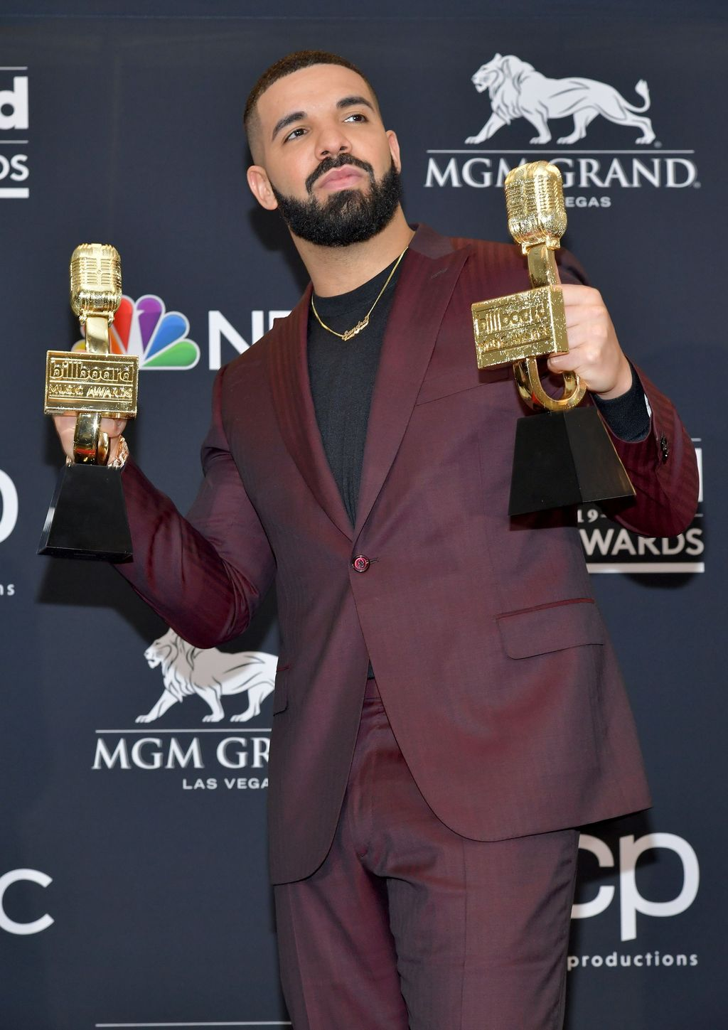 """LAS VEGAS, NEVADA - MAY 01: Drake poses with the awards for Top Artist, Top Male Artist, Top Billboard 200 Album for """"Scorpion"""", Top Billboard 200 Artist, Top Hot 100 Artist, Top Streaming Songs Artist, Top Song Sales Artist, Top Rap Artist, Top Rap Male Artist in the press room during the 2019 Billboard Music Awards at MGM Grand Garden Arena on May 01, 2019 in Las Vegas, Nevada. (Photo by Amy Sussman/Getty Images for dcp)"""