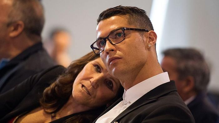 MADRID, SPAIN - NOVEMBER 07:  Cristiano Ronaldo of Real Madrid looks on with his mother Maria Dolores dos Santos Aveiro during his press conference after signing a new five-year contract with the Spanish club at the Santiago Bernabeu stadium on November 7, 2016 in Madrid, Spain.  (Photo by Denis Doyle/Getty Images)
