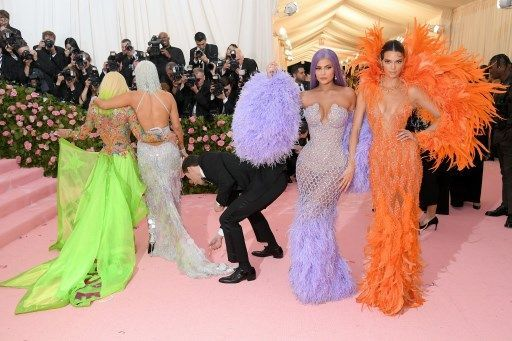 """(L-R) Models Kylie Jenner, Kendall Jenner, singer Jennifer Lopez and designer Donatella Versace arrive for the 2019 Met Gala at the Metropolitan Museum of Art on May 6, 2019, in New York. - The Gala raises money for the Metropolitan Museum of Art's Costume Institute. The Gala's 2019 theme is """"Camp: Notes on Fashion"""
