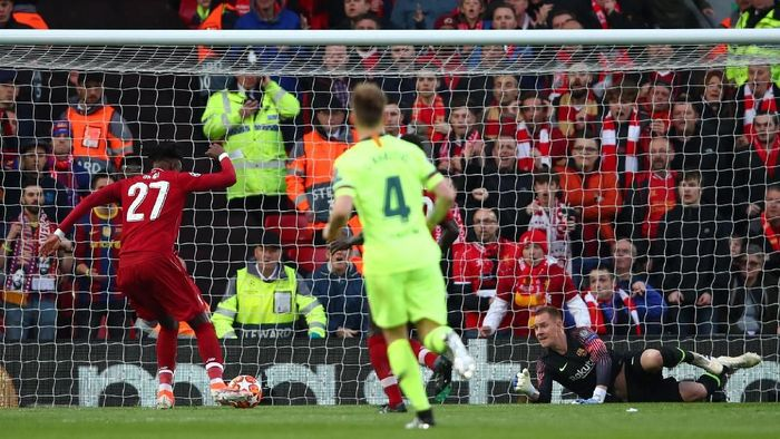 LIVERPOOL, ENGLAND - MAY 07:  Divock Origi (27) scores his teams first goal during the UEFA Champions League Semi Final second leg match between Liverpool and Barcelona at Anfield on May 07, 2019 in Liverpool, England. (Photo by Clive Brunskill/Getty Images)