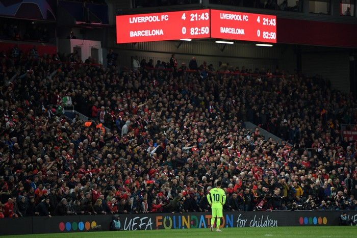 LIVERPOOL, ENGLAND - MAY 07:  Lionel Messi of Barcelona looks dejected as the scoreboard reads 4-0 during the UEFA Champions League Semi Final second leg match between Liverpool and Barcelona at Anfield on May 07, 2019 in Liverpool, England. (Photo by Shaun Botterill/Getty Images)
