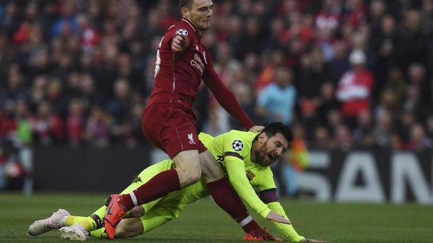 Lionel Messi tidak mampu menyelamatkan Barcelona dari pembantaian di Anfield.