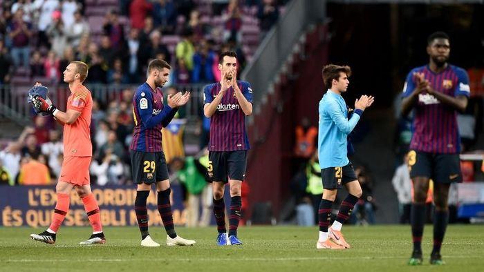 Barcelona mengalahkan Getafe 2-0, tapi masih dibayangi kekecewaan karena dikalahkan Liverpool. (Foto: Josep Lago / AFP)
