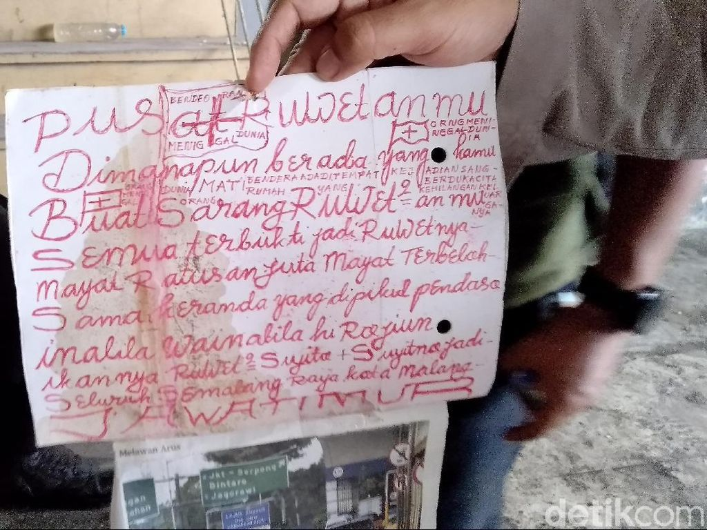 Kertas dengan Tulisan Warna Merah Ditemukan di Lokasi Mayat Mutilasi