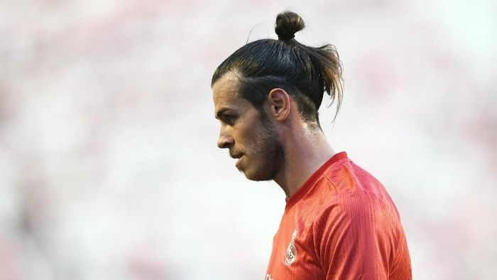 Gareth Bale disarankan agar meninggalkan Real Madrid (Foto: Denis Doyle / Getty Images)