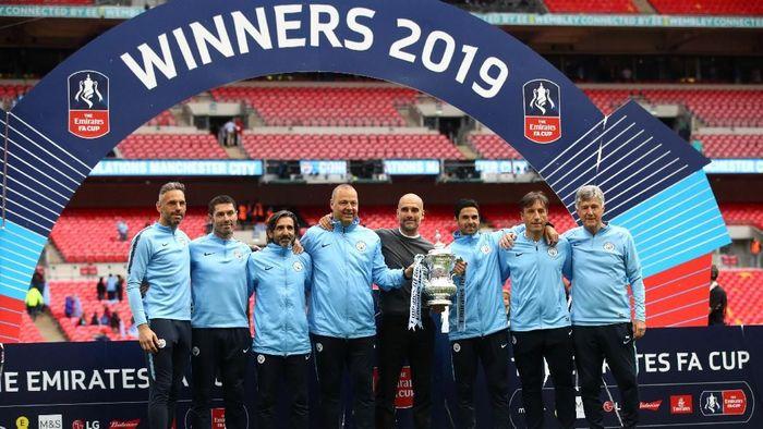 Pep Guardiola yakin akan ada tim yang menyamai sejarah Manchester City. (Foto: Julian Finney/Getty Images)