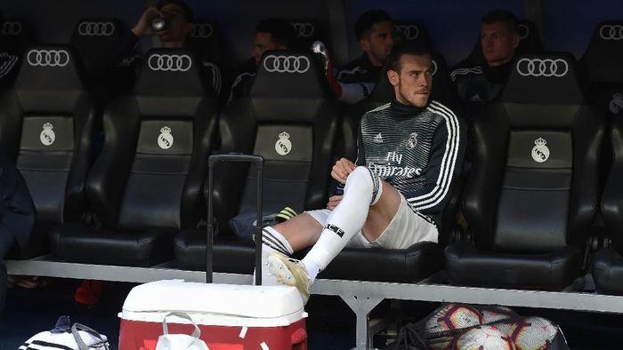 Gareth Bale hanya duduk di bench pada laga terakhir Real Madrid di Liga Spanyol musim ini (Denis Doyle/Getty Images)