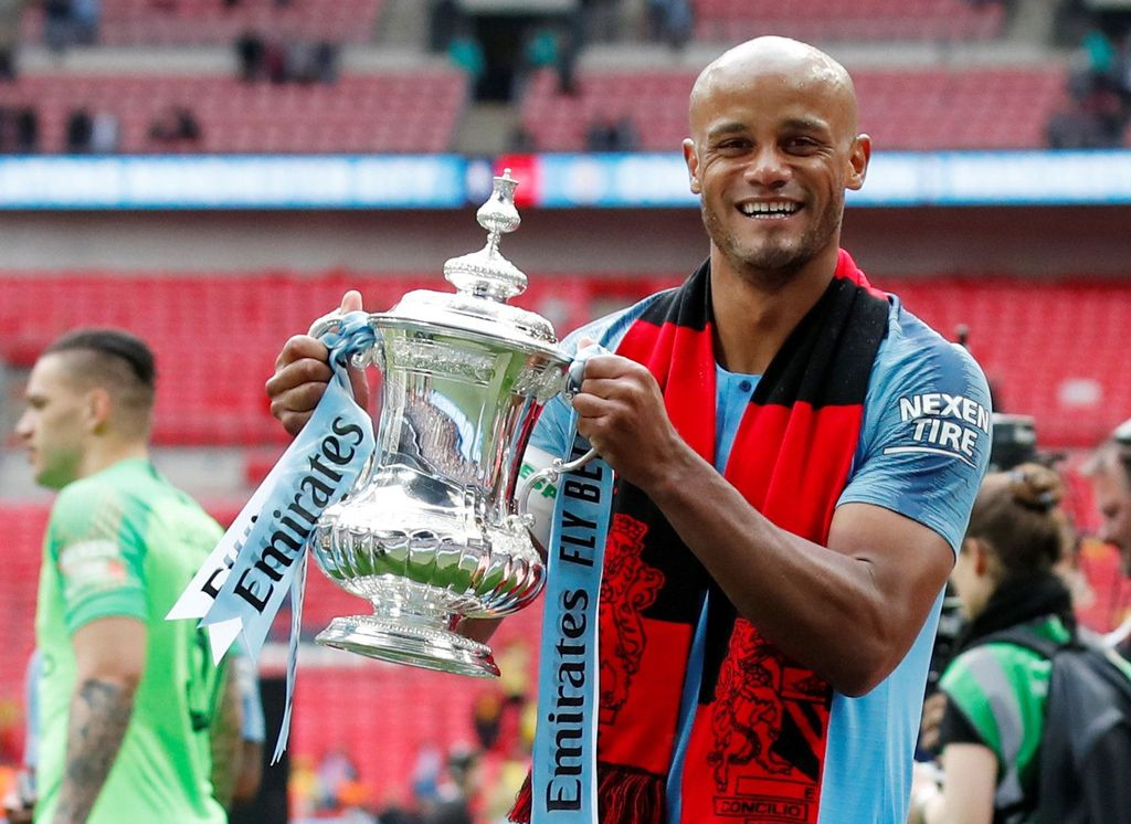 Soccer Football -  FA Cup Final - Manchester City v Watford - Wembley Stadium, London, Britain - May 18, 2019  Manchester City's Vincent Kompany celebrates with the trophy after winning the FA Cup                  REUTERS/David Klein