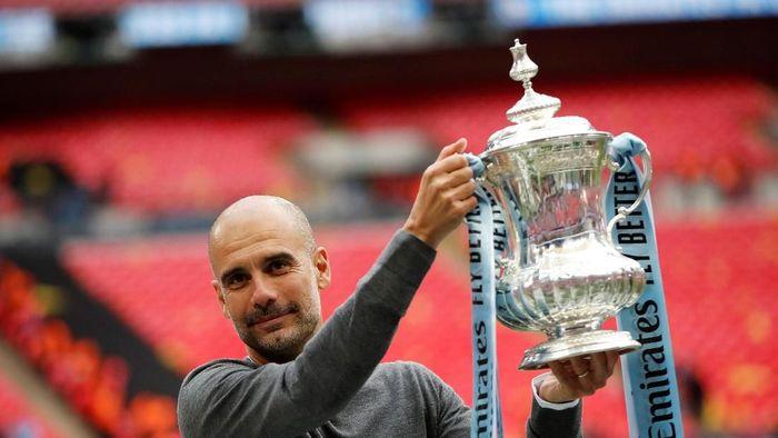 Treble domestik lebih sulit untuk Pep Guardiola ketimbang Liga Champions (John Sibley/Reuters)