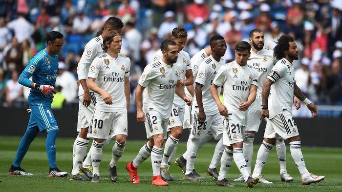 Real Madrid janji bangkit musim depan, tapi tak mau pasang target muluk-muluk. (Foto: Denis Doyle / Getty Images)
