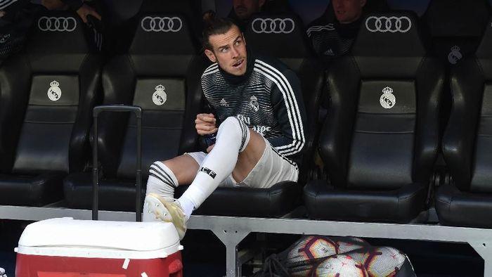 Gareth Bale tak mau pergi kalau tak ada tawaran yang tepat, ancam akan bertahan di Real Madrid. (Foto: Denis Doyle / Getty Images)
