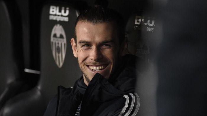 Gareth Bale sangat mungkin bertahan di Real Madrid musim depan  (JOSE JORDAN / AFP)