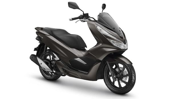 Honda PCX dilaburi warna Magnificient Matte Brown.