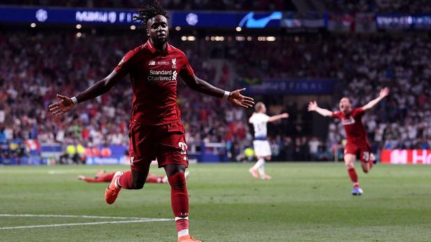MADRID, SPAIN - JUNE 01: Divock Origi of Liverpool celebrates after scoring his team's second goal during the UEFA Champions League Final between Tottenham Hotspur and Liverpool at Estadio Wanda Metropolitano on June 01, 2019 in Madrid, Spain. (Photo by Laurence Griffiths/Getty Images)